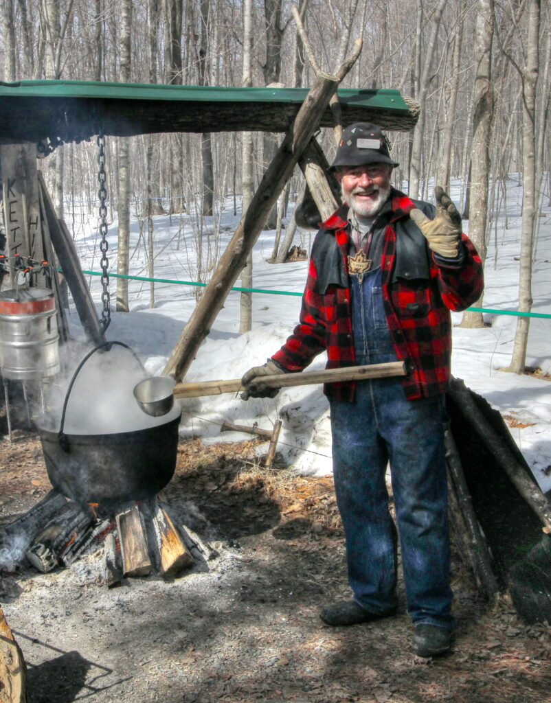man brewing sap in kettle