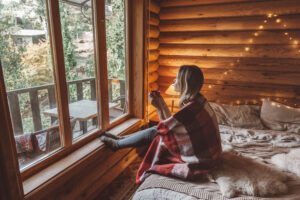 Woman,In,Warm,Blanket,Relaxing,And,Drinking,Morning,Coffee,On