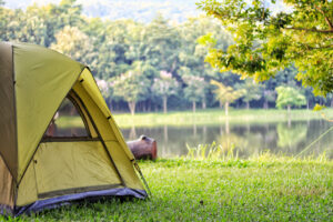 tent with lake in the background